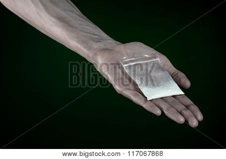 The Fight Against Drugs And Drug Addiction Topic: Dirty Hand Holding A Bag Addict Cocaine On A Dark