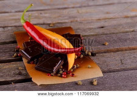 Red And Yellow Chili Peppers With Dark Chocolate