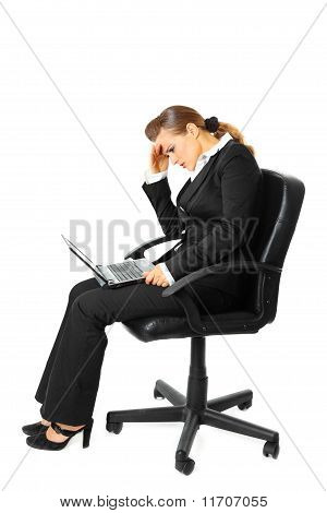 Tiredness modern business woman sitting on chair and using laptop isolated on white