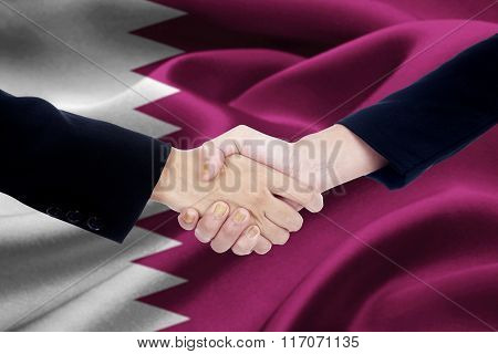Agreement Handshake With Flag Of Qatar