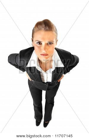Full length portrait of displeased business woman with hands on hips isolated on white