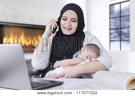 Businesswoman Working While Holding Her Baby