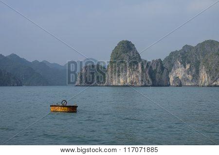 Beautiful Limestone Mountain Scenery With Yellow Buoy At Ha Long Bay, North Vietnam. Cloudy Winter W