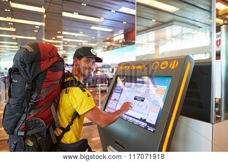 SINGAPORE - NOVEMBER 04, 2015: passenger at Changi Airport. Singapore Changi Airport, is the primary civilian airport for Singapore, and one of the largest transportation hubs in Southeast Asia