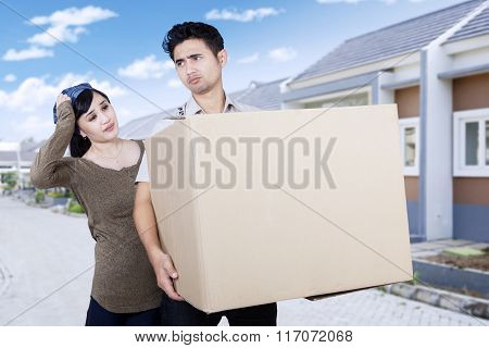 Confused Couple Moving From New House