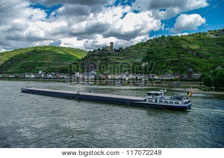 Cargo Ship On Rhine River. Germany. Romantic Gutenfels Medieval Castle, Hills With The Famous Vineya