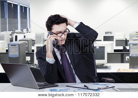 Depressed Middle Eastern Worker In Office