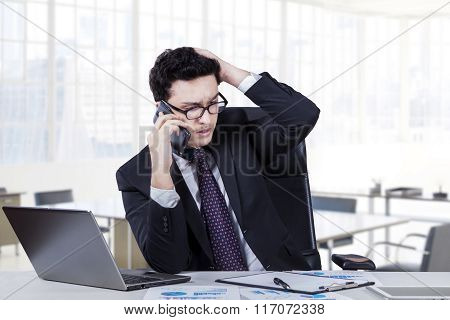 Depressed Worker Speaking On The Phone