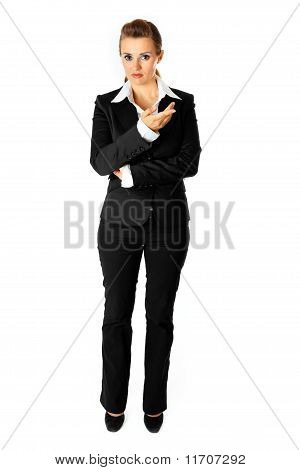 Full length portrait of reasoning modern business woman isolated on white