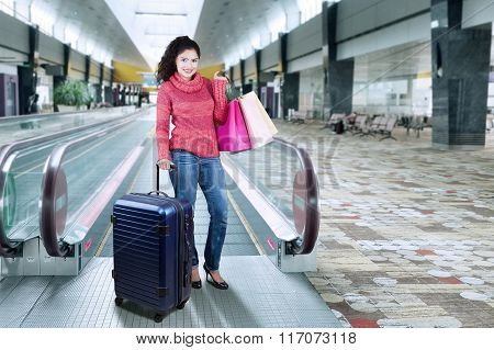 Indian Woman Standing In The Airport Hall