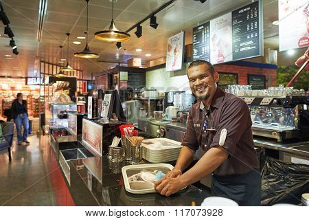SINGAPORE - NOVEMBER 03, 2015: portrait of Costa Coffee barista. Costa Coffee is the second largest coffeehouse chain in the world behind Starbucks and the largest in Britain