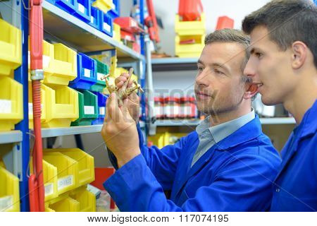 Man selecting plumbing fittings from stores