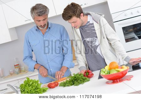 father and son in the kitchen