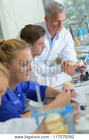 Technicians working in dental laboratory