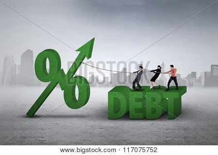Workers Pulling Percentage Sign Of Debt