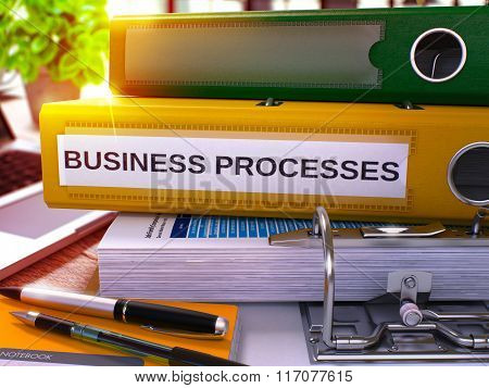 Business Processes on Yellow Office Folder. Toned Image.