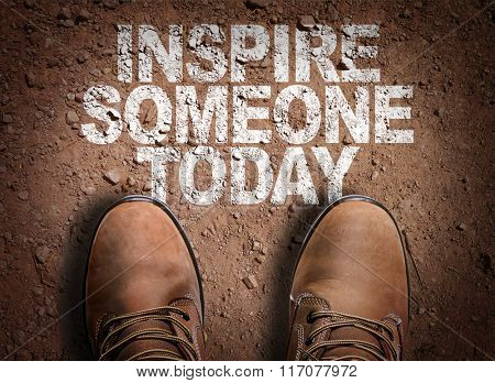 Top View of Boot on the trail with the text: Inspire Someone Today