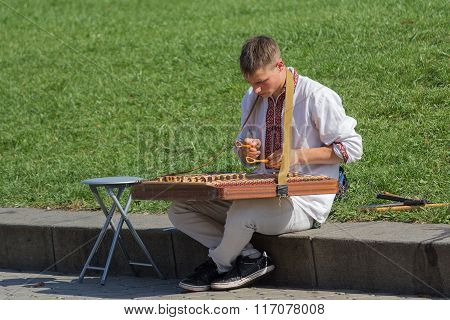 Kiev, Ukraine - September 20, 2015: Male In Ethnic Dress Playing The Cymbals At Independence Square