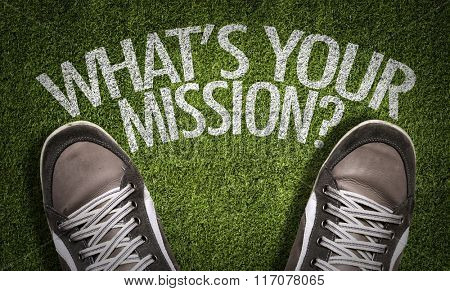 Top View of Sneakers on the grass with the text: Whats Your Mission?