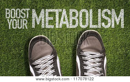 Top View of Sneakers on the grass with the text: Boost Your Metabolism