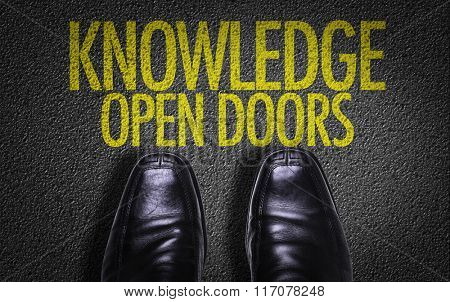 Top View of Business Shoes on the floor with the text: Knowledge Open Doors