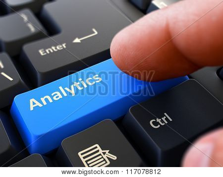 Finger Presses Blue Keyboard Button Analytics.