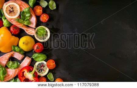 Raw Salmon Steaks And Fresh Ingredients For Cooking. Frame