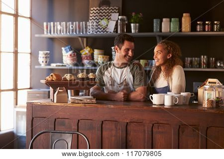 Couple Running Coffee Shop Standing Behind Counter