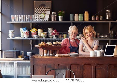 Portrait Of Staff At Coffee Shop Standing Behind Counter
