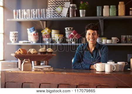 Portrait Of Female Coffee Shop Owner Standing Behind Counter
