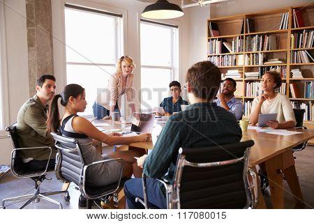 Businesswoman Addressing Team Meeting Around Table