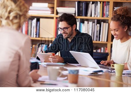 Business Team Meeting Around Table For Brainstorming Session