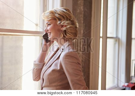 Businesswoman On Mobile Phone In Office