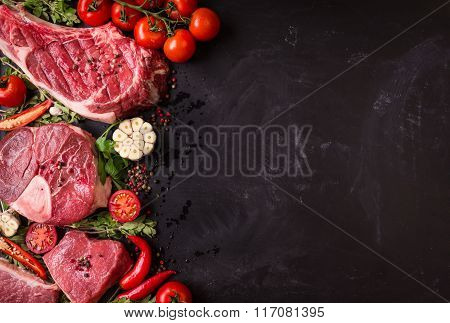 Raw Meat Steaks On A Dark Background Ready To Roasting