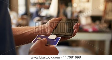 Credit Card Reading Device Attached To Mobile Phone