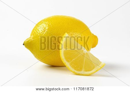 close up of fresh juicy lemon on white background