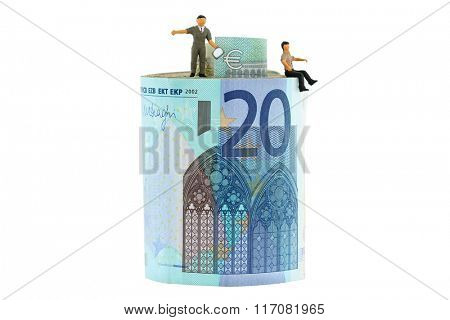 2 miniature men standing and sitting on a roll of Euro banknote bills, isolated on white