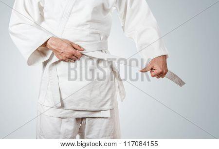 Man Tying Kimono Belt