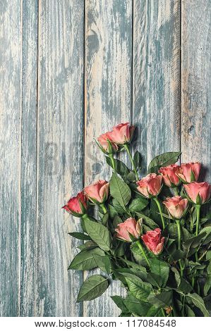 Grunge Wooden Background With Pink Roses Bouqet