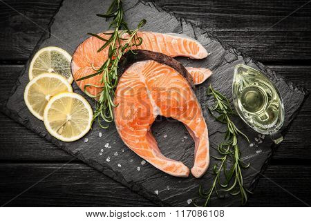 Fresh salmon slice on old wood