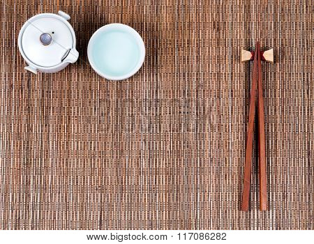 Bamboo Mat With Traditional Asian Utensils And Tea