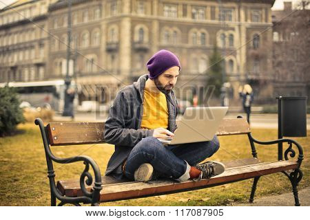 Technological man on a bench