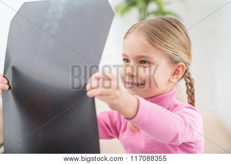 Little girl holding her radiogram