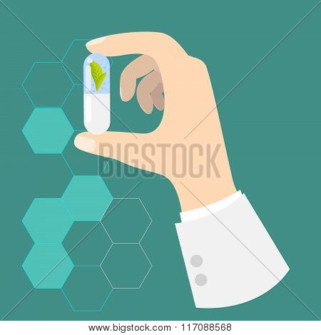 Hand of a doctor holding drug capsule.