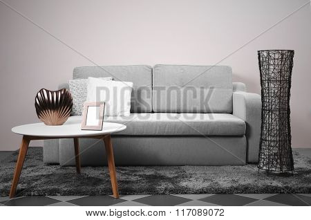 Interior with modern furniture: sofa, table, lamp.