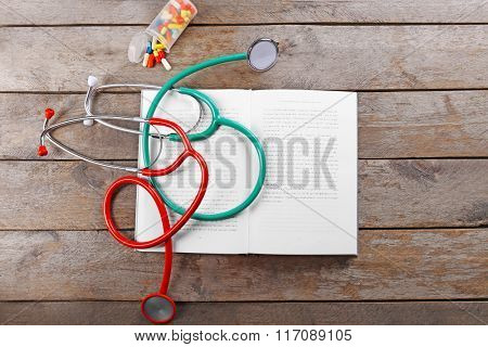 Stethoscopes on a book
