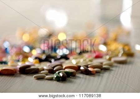 Pile of colourful tablets on the table, close up