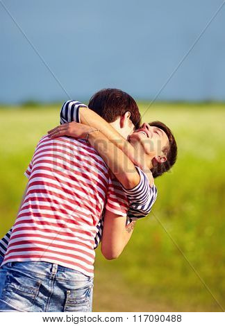 Young Male Couple Embracing Outdoors