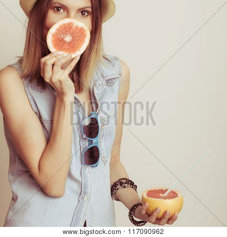 Woman Covering Her Mouth With Grapefruit. Fun Summer