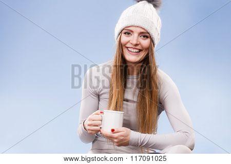 Girl In Thermal Underwear Drinking Tea